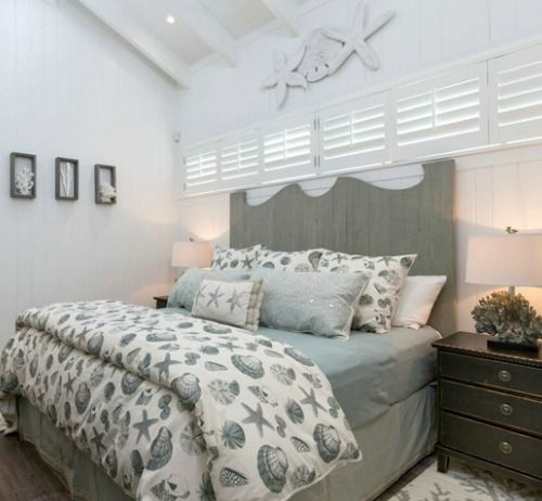 Gray Bed And Bedding With A Coastal Theme
