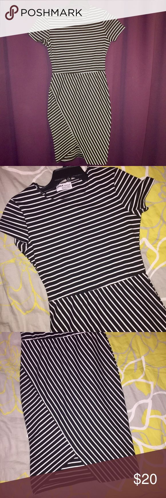 Black and white midi bodycon dress from Zara! Midi black and white bodycon dress with asymmetrical hem line at the bottom. Only worn once! Super classy and super flattering! Zara Dresses Midi