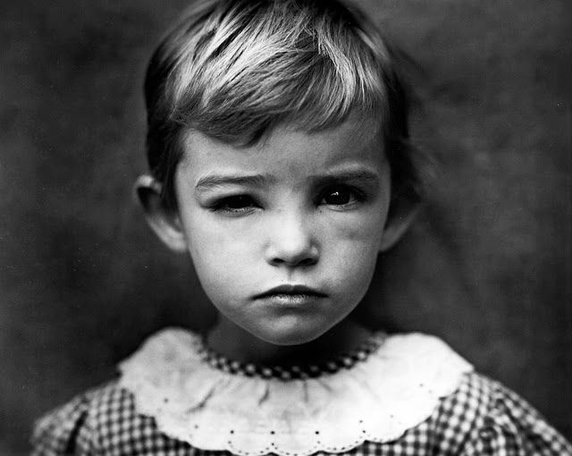 Sally Mann. Asymmetry in an otherwise very simple headshot.
