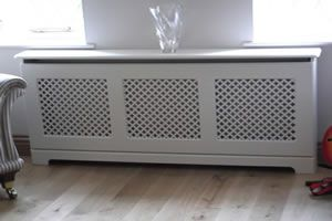 Learn how to fit a Radiator Cabinet - it's a great way to hide an ugly radiator - with the help of this DIY Heating Guide.