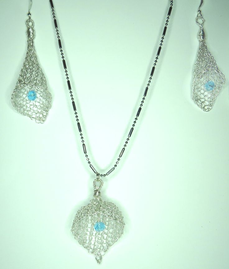 silver non tarnish wire and blue crystals, were used to crochet a pair of ear rings and a necklace charm
