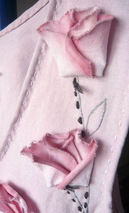 How to make raw-edged flower ornamentation for clothing.