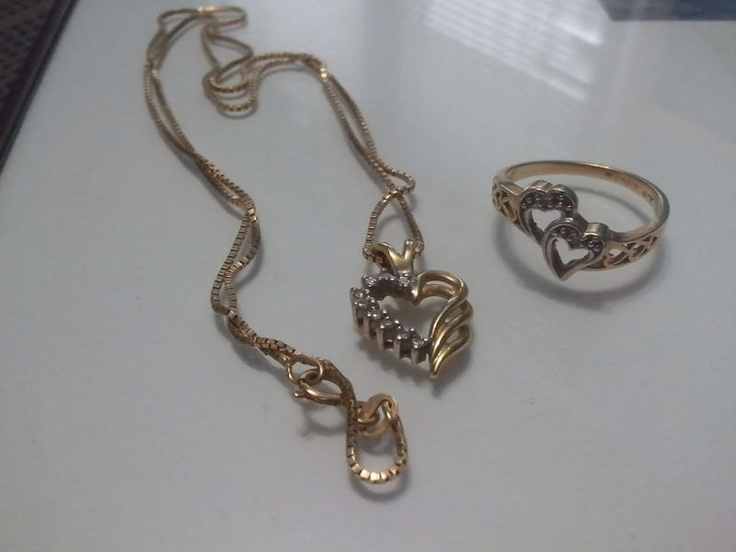 $400 for Set  - The ring was appraised for $350 - The necklace was appraised for $500  - Immaculate condition!  - Originally purchased at Birks Jeweler  ** Necklace - pendant and chain are 14k Italian gold with tiny diamond flecks in heart pendant - Two-tone 14k Italian gold (yellow and white).  - Long 14k Italian gold chain   ** Ring - 10k Italian gold ring with tiny flecks in the hearts. - Two-tone 10k Italian gold.  - Ring size 6-6.5   More photos available at request.