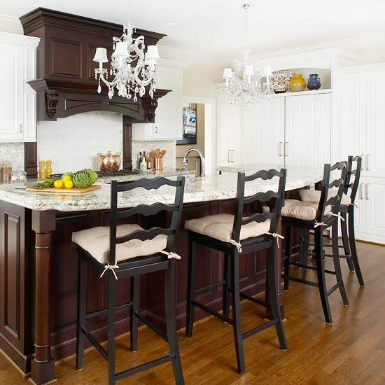 Rich cherry wood cabinets, sparkling chandeliers and a gorgeous island...a perfect kitchen trio...