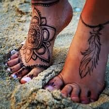 Image result for women's foot tattoos henna style
