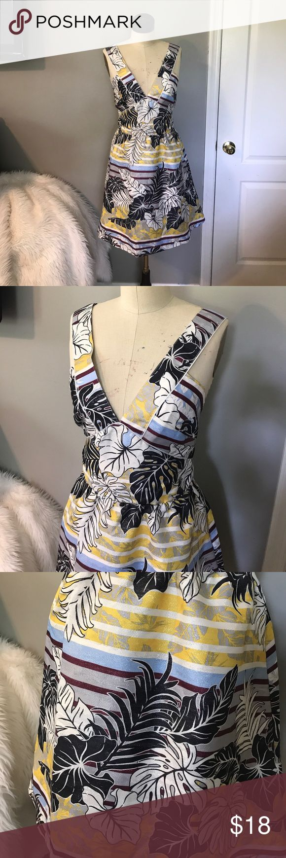 BNWT! Tropical metallic dress w/ adorable cutouts Dress by H and M. This dress is gorgeous and perfect for spring and summer, vacay, parties, date night, etc! Size 14. Brand new with tags still on! Adorable details and design! H&M Dresses Midi