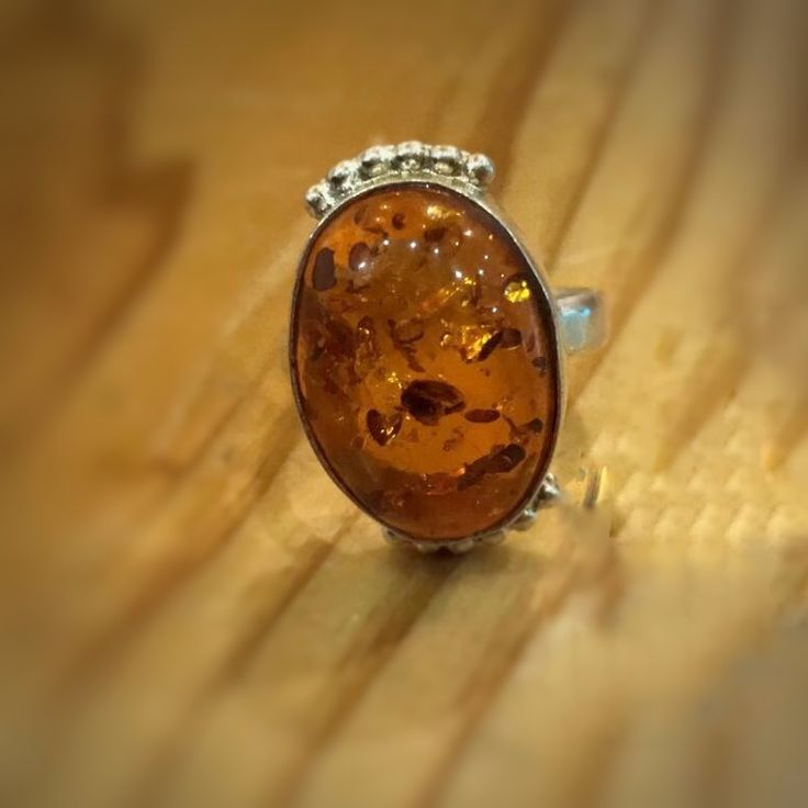 Amber ring | Amber stone often considered a gemstone, the glowing, warm amber is not actually a stone, but a fossilized resin from ancient evergreen trees. The oldest amber discovered on Earth is about 320 million years old. Imagine the incredibly powerful energy this amber contains!  The young amber stones are less than 100,000 years old; the most valued pieces of amber are much older than that. (It takes a long time for the tree resin to become true amber).