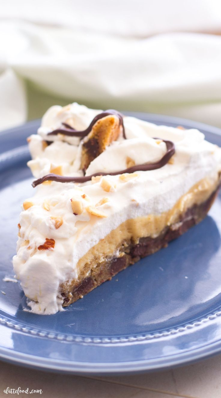 This rich chocolate chip cookie peanut butter cream pie is an easy dessert that tastes like a little slice of heaven! The pie crust is a homemade chocolate chip cookie, and the peanut butter filling is made with peanut butter, pudding, and whipped cream. The pie is topped with homemade whipped cream, chopped peanuts, chocolate chip cookies, and melted chocolate. Pure chocolate decadence. Plus, a step-by-step video below!