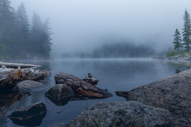 Thick clouds landing on the dreamy Mason Lake in Washington