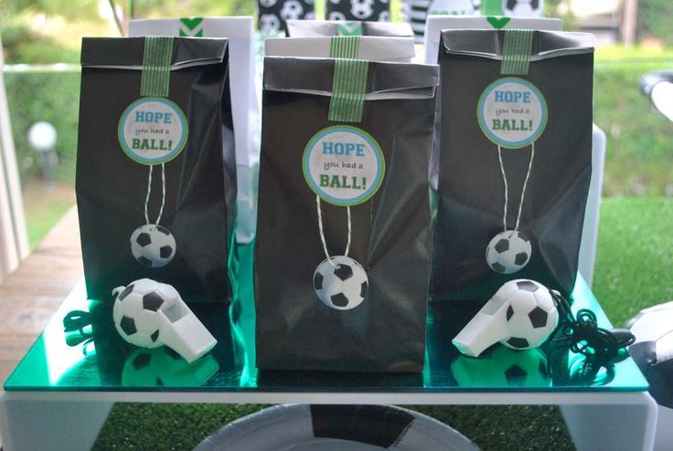 Fun favor bags at a soccer baby shower party! See more party planning ideas at CatchMyParty.com!