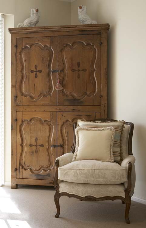 An elegant armoire can easily hold day-to-day clutter