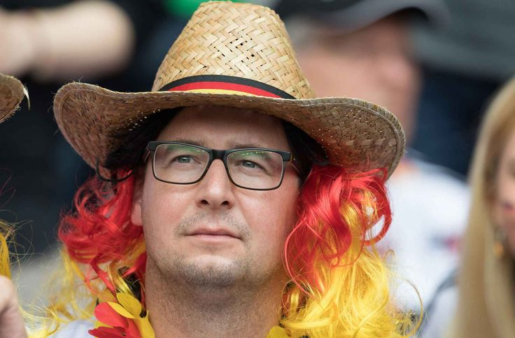 Fan of Germany, double of French President Francois Hollande attends the Euro…