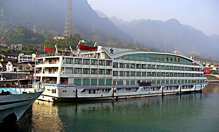 YANGTZE RIVER - CHINA - THREE GORGES DAM - Here we find several large river cruise ships at dock.