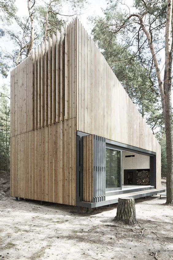 Lake Cabin / FAM Architekti. Architecture. Vacation Home. Wood. Angle. Slats. Folding Door. Woods. Forest. Design.