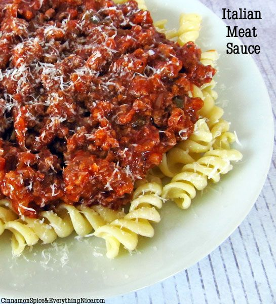 Italian Meat Sauce and Pasta Made with ground beef and Italian sausage, bell pepper, onion, garlic, red and black pepper, salt, canned crushed tomatoes, tomato paste, bay leaf, olive oil,  and served over noodles like Rotini with nooks and crannies to hold the sauce. Top with fresh grated Parmesan or similar cheese.  Yummmmm