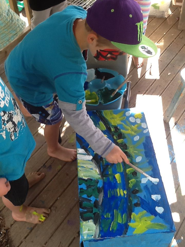 Little artist he was painting this work with the other two boys.