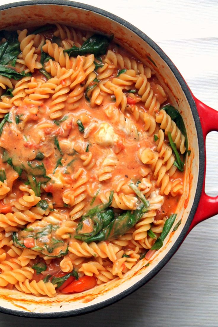 One pot pasta with tomato and mascarpone sauce, spinach and fresh basil