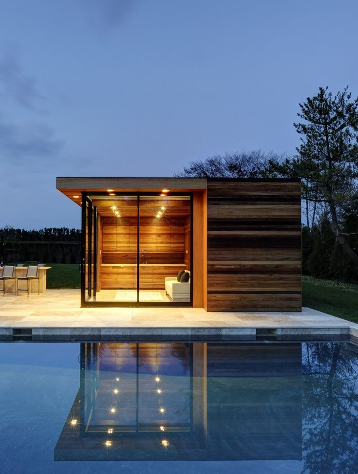 Bates Masi Architects. Built as a pool house, this would make a lovely small home. I love the horizontal striping of the wood exterior.