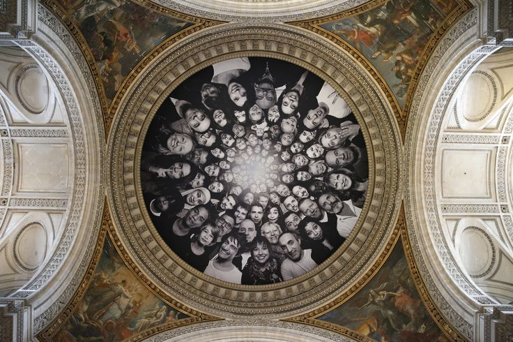 Portraits by contemporary artist JR, collected during the month of March 2014, displayed under the dome of the Pantheon in Paris on May 7, 2015.