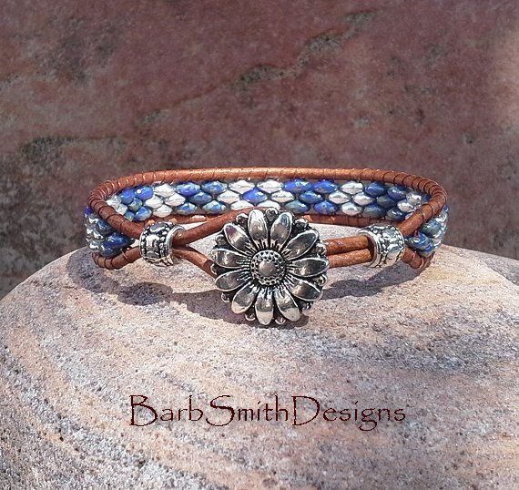 The Skinny One in Denim  This slender single-wrap beaded cuff bracelet features Opaque Blue Picasso and silver Super Duo beads on a light brown Indian leather cord. The closure is a 5/8 silver daisy button and single leather loop, accented with silver spacer beads on each side. This bracelet is available in various wrist sizes: 6 6 1/4 6 1/2 6 3/4 7 7 1/4  Please choose your exact wrist size at checkout - a little extra has been added for comfort and fastening. (Bead pattern may vary…