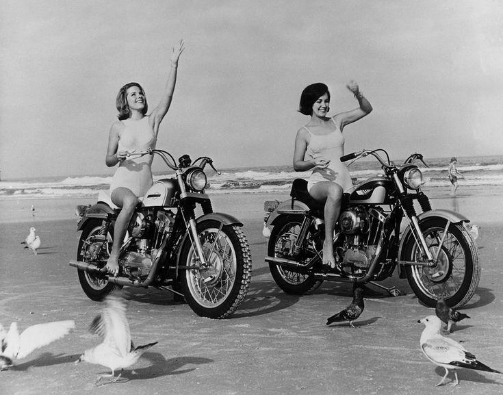 Women feeding seagulls on motorcycles in Daytona, Fla., 1968.