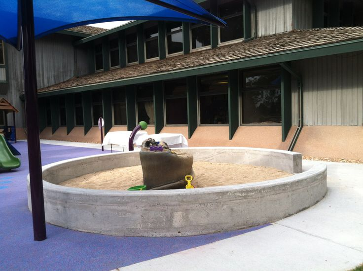 Sand can feel good on hands and arms and the water washes everything away!  STAR Center playground - Greenwood Village, CO