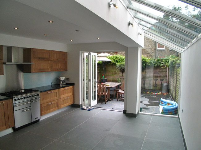 We love this kitchen glass roof extension with bi-folding door, would love to give this project a go visit www.csggroup.co.uk