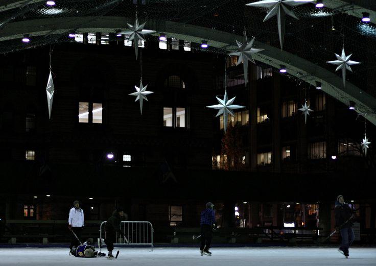 hockey at nathan phillips square. Toronto, Canada.