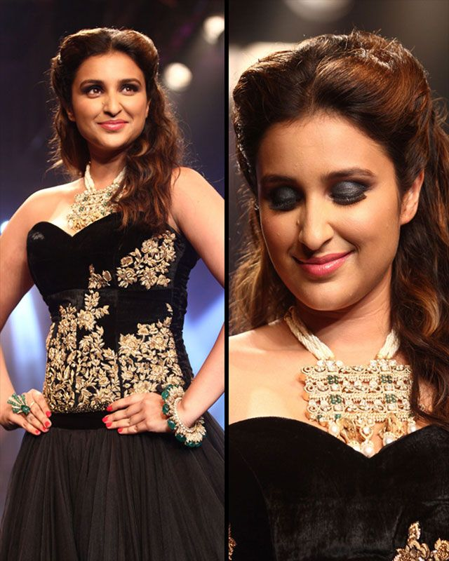 She completed her look with a heavy pearl necklace and loose wavy half up and half down hairstyle.