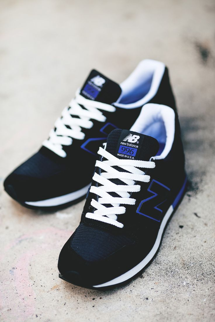 black and blue new balance trainers