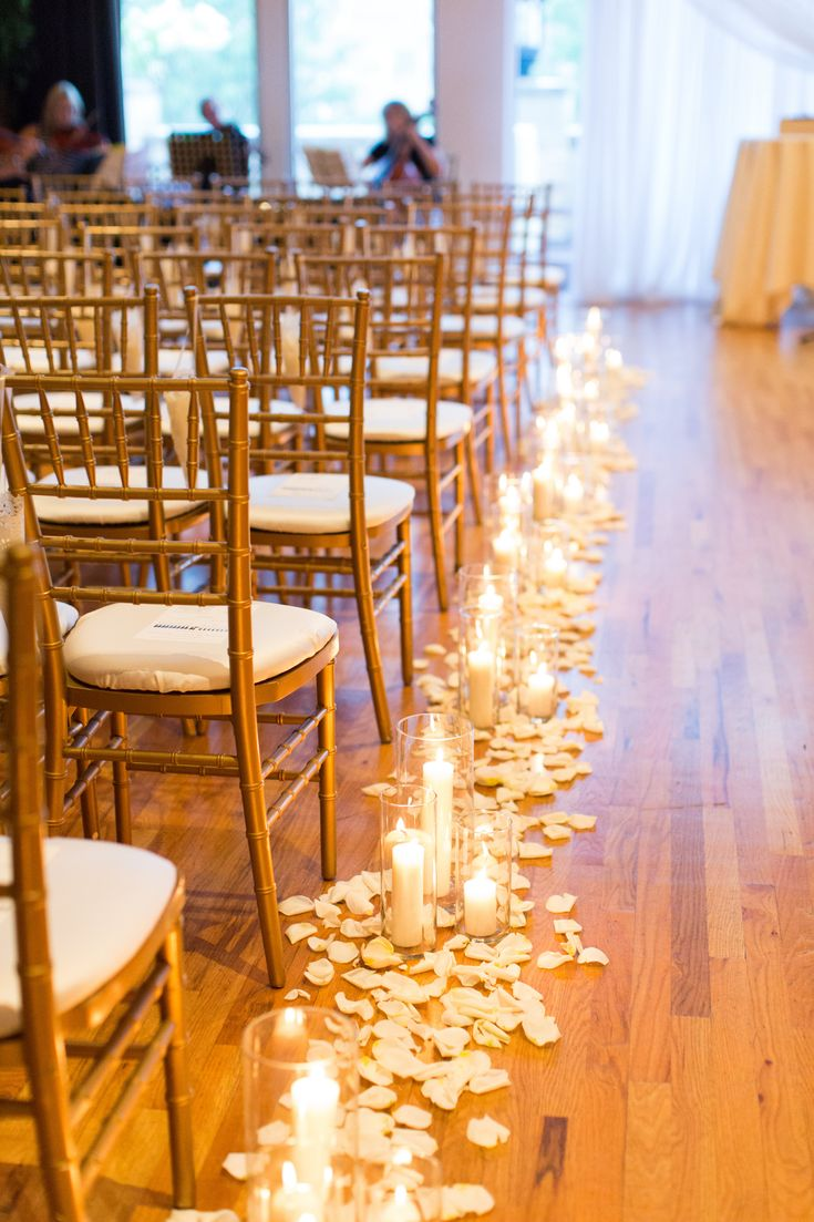 candles down the aisle, wedding candles, petals lining the aisle, flower petals down the aisle, hurricane vases