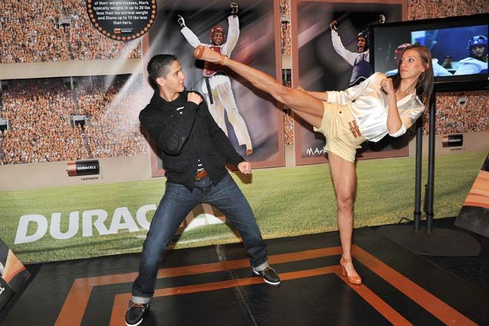 Duracell | Go for the Gold | Olympic Event    At one station, taekwondo champions Diana Lopez and Mark Lopez showed off their moves, while TV screens displayedhighlights from past competitions.