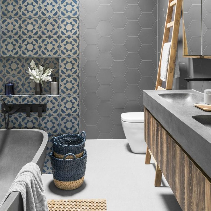 Make a splash in your bathroom with colourful feature tiles and touches of timber #bathroominspiration #bathroom #hbmystyle 📷 @gemmola…