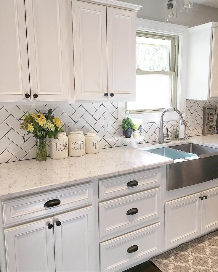 White kitchen, kitchen decor, subway tile, herringbone subway tile, farmhouse si…