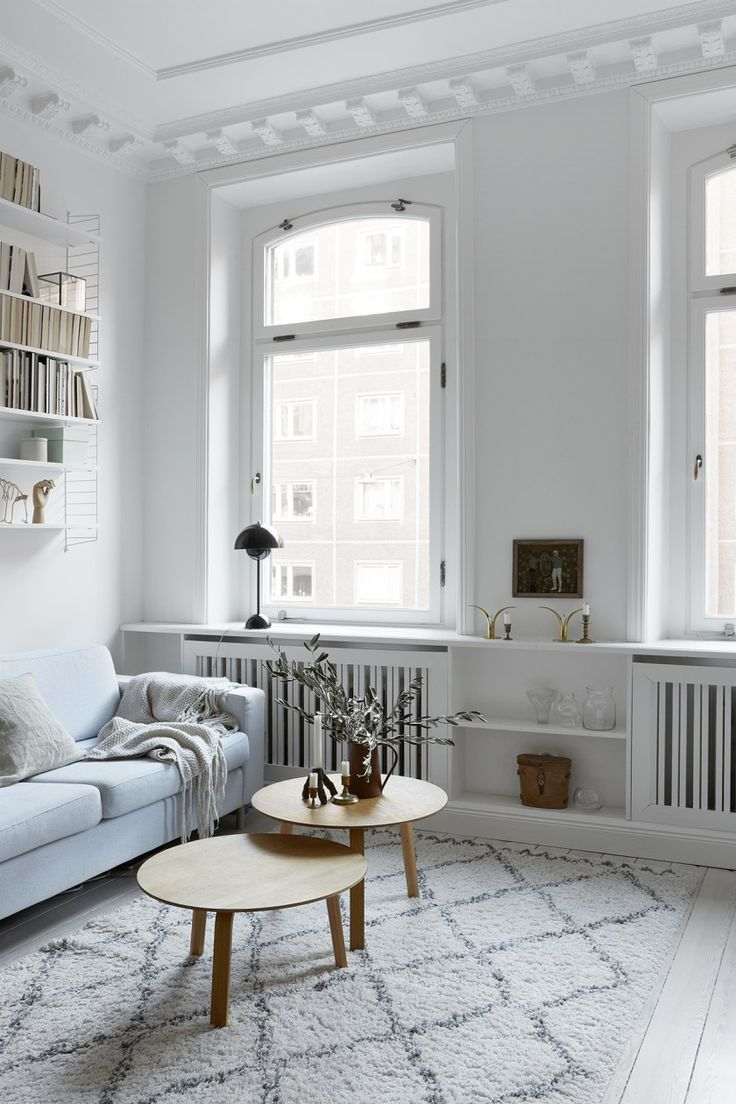 Light, bright living room, with period details, painted wooden floors, and Scandi style furniture. Love the String shelf and Moroccan Beni Ourain style rug