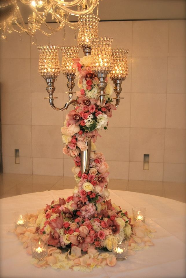 Crystal candelabra with roses, orchids, spray roses, hydrangea including a wreath at the bottom