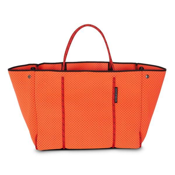 ESCAPE bag in hot coral. The originators and creators of the perforated neoprene Escape carryall bag. 100% designed and handcrafted in Australia.