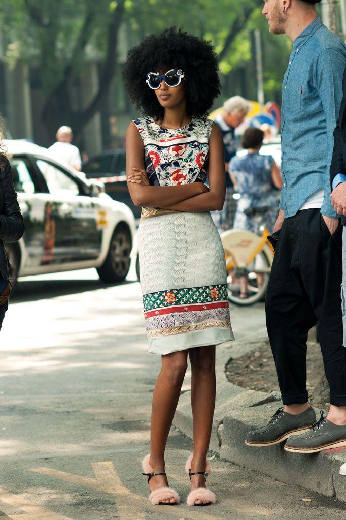Stylish woman walking the city streets.