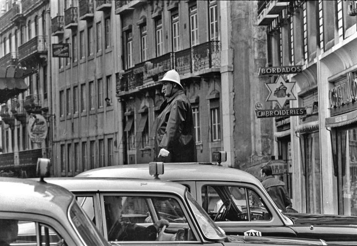 TRAFFIC COP WITH CAR ROOFS   NEAL SLAVIN PHOTOGRAPHY