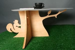 http://www.luxuryhousingtrends.com/squirrel-and-tree-coffee-table.jpg