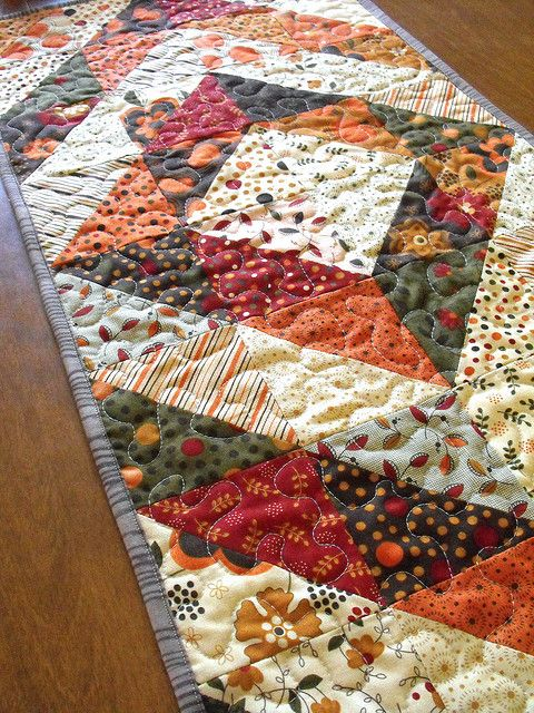 If I ever had or made a quilt, I think I'd want to do something like this design. But in blues and purples or red orange and brown.