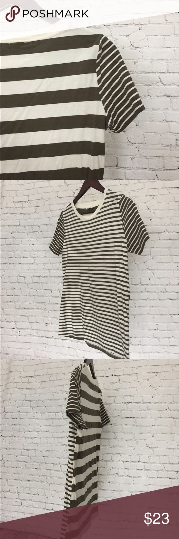 COS Army Green Striped T-Shirt Comfy and cute. Army green and white striped t-shirt from one of my favorite brands! Contrast stripes on the sleeve give it a modern feel. Stripes the the front are smaller than the back. Great condition, only worn a couple times.  COS is known for high quality basics and is a well-kept secret choice across fashion editors. COS Tops Tees - Short Sleeve