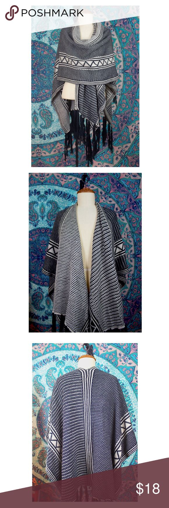B&W Fringed Shawl This amazing fringed shawl is functional and fashionable. Wear it draped around your shoulders or wrap it around you. Layer it under coats and light jackets or wear it over a long sleeve in fall. Perfect for transitional seasons and for layering on those colder days. Belt it, layer it, wrap yourself up tight. I received this as a gift and already have so many of this style. Never been worn. Francesca's Collections Accessories Scarves & Wraps
