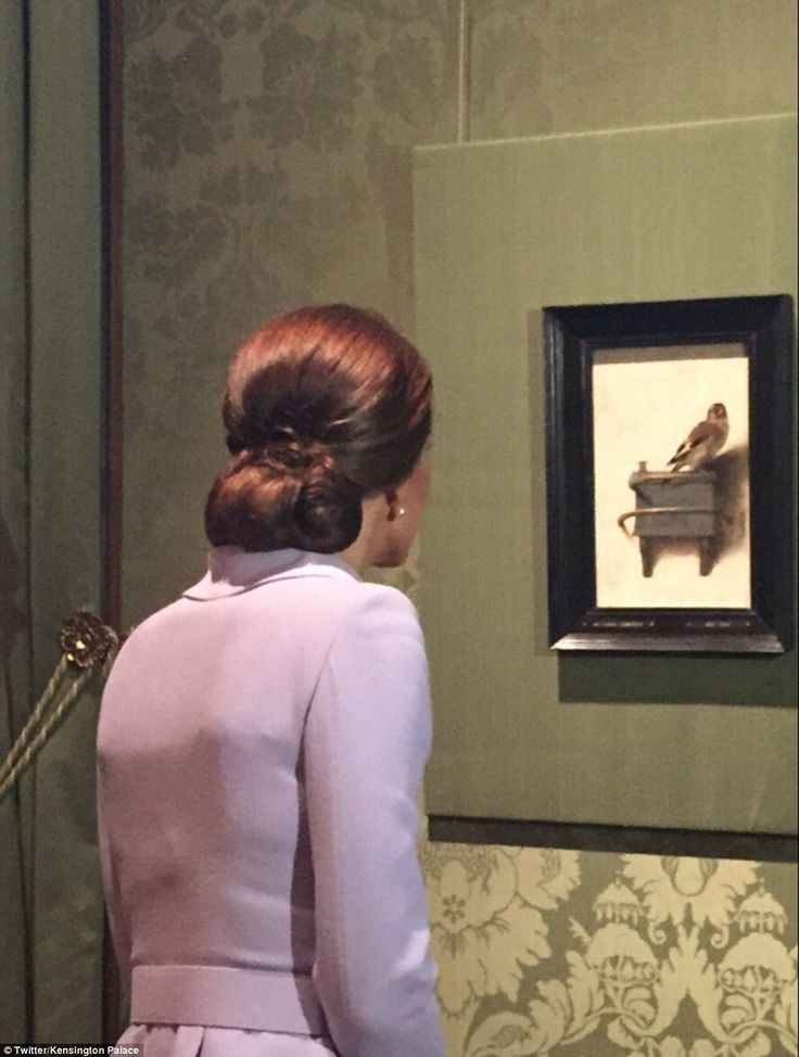 History of art graduate Kate leans in to admireThe Goldfinch by Carel Fabritius during a private tour of the Mauritshuis gallery