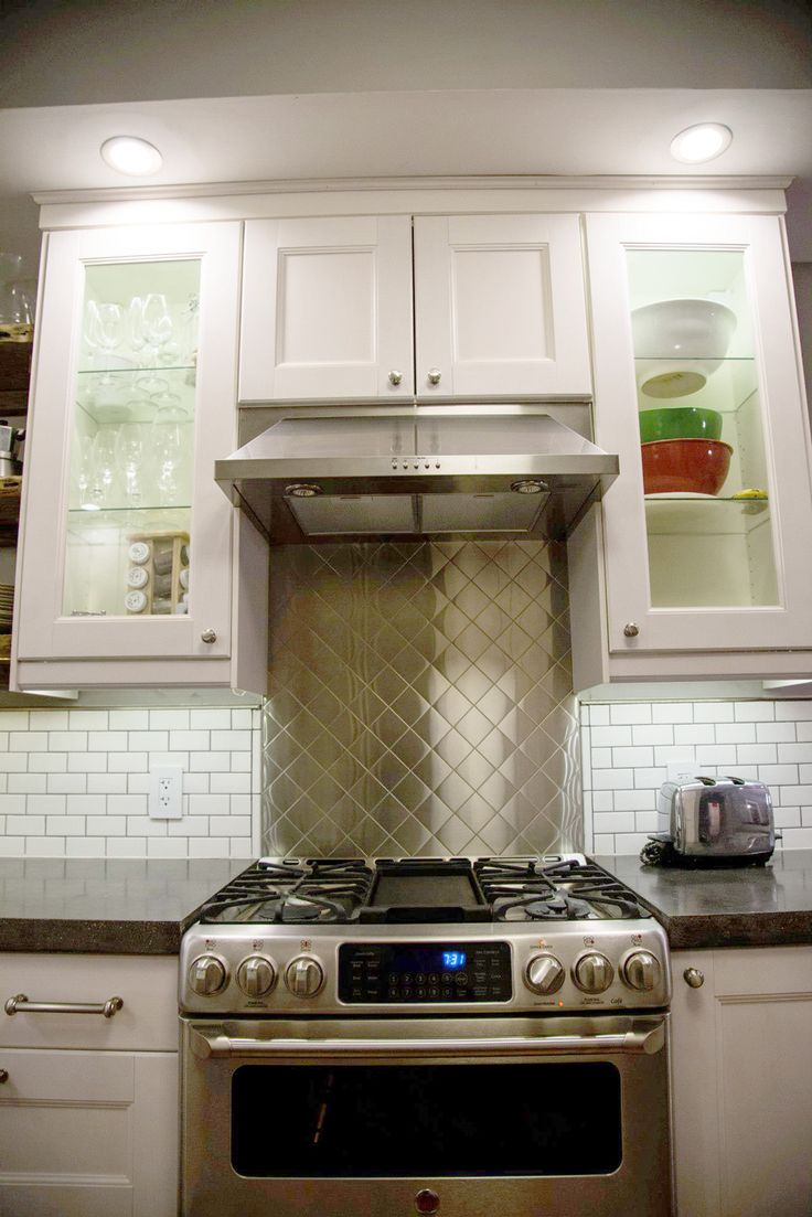 A stainless steel backsplash united our consumer-grade range and hood, giving them a more industrial look. (Click through for more photos.) | Hammer & Moxie