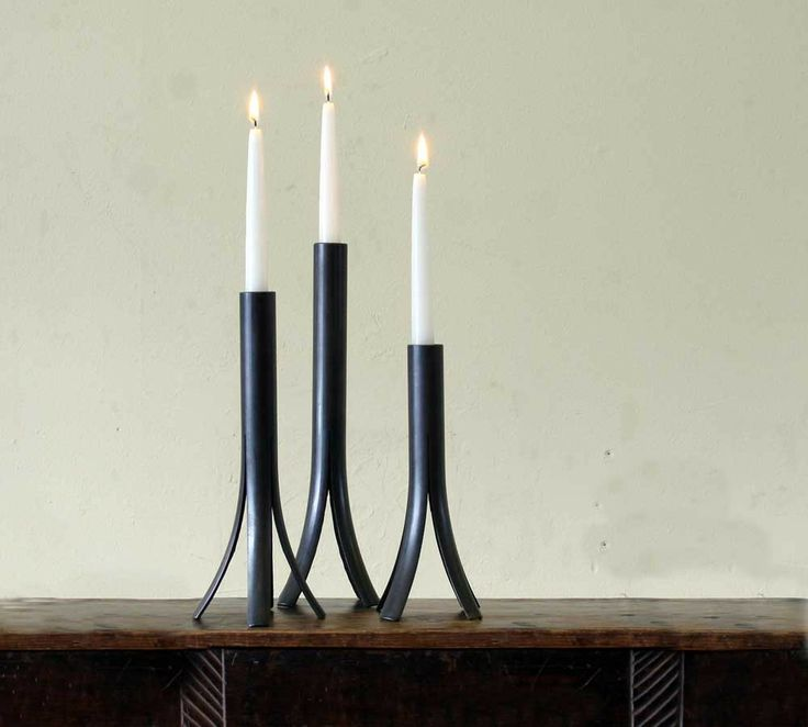 """Pipe Candle Holders (Set of 3): This is one of those simple ideas that, when you see it, you think """"how has this not been done before?!?""""  It's a steel pipe that is cut and flared at the end so it has 4 kickstands, kind of like the lunar landing of Apollo 11."""