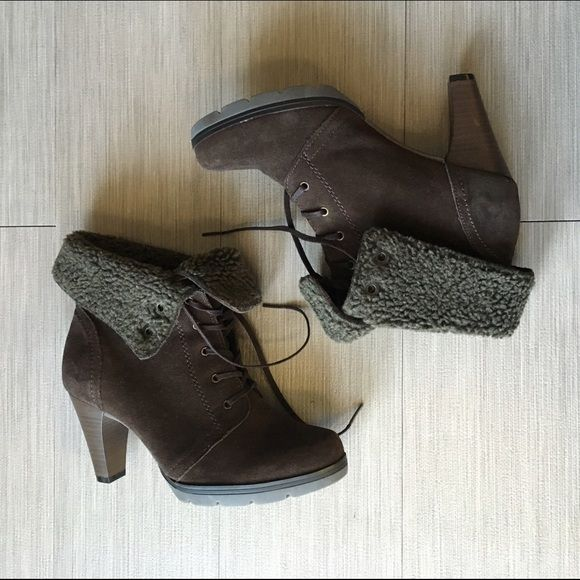 Flexi brown suede foldable booties Brown suede booties by Flexi. Comfortable heel height. Foldable faux-fur cuffs. Convertible boot height. Wear them folded with tights or skinny pants. Wear them unfolded with pants or flared jeans. Lightly worn, very minor signs of wear. In very good condition! Flexi Shoes Ankle Boots & Booties