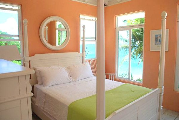 peach color masterbed room | Stay Warm This Winter in a Tropical Bedroom