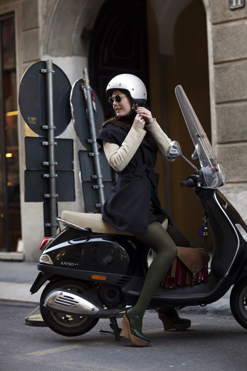 by Sartorialist...I absolutely love/adore well dressed women & men on bikes & vespas in europe...saw this all over paris on a recent trip