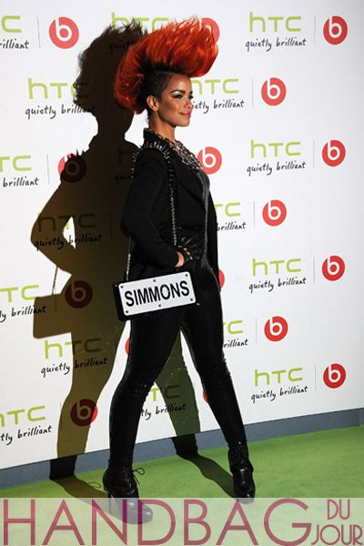 Singer-Eva-Simmons and her shocking red mohawk hairdo attended the HTC and Beats Audio party at The Roundhouse in London, England carrying a black and white license plate bag with her last name (